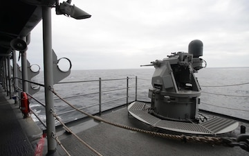 MK-38 25 MM machine gun system fires from amphibious assault ship USS Boxer (LHD 4) during an integrated live fire exercise