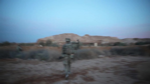 Coalition partners from the United Kingdom peform security patrol at Al Asad