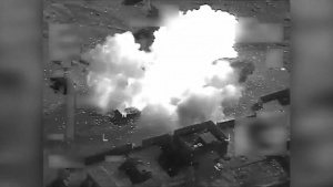 Coalition airstrike destroys a Da'esh held building near Mosul, Iraq