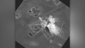 Coalition airstrike destroys an ISIL-held building near Mosul, Iraq.