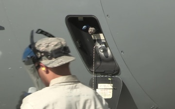 Airman filling C-130 with Liquid Oxygen