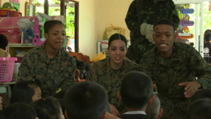 Cobra Gold 2017: U.S. Marine Corps Lance Cpl. Dominic Edwards interacts with children