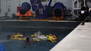 Marines conduct water survival training with Spanish instructors