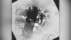Coalition airstrike destroys an ISIS-held building near Al Bab, Syria.