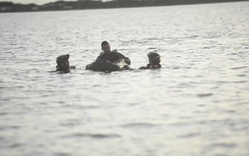Airmen and Seamen Conduct Search and Rescue Training