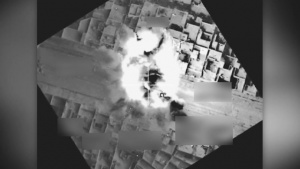Coalition airstrike destroys an ISIS roadblock near Mosul, Iraq.