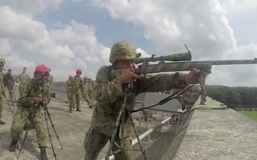 Marines with the 3rd Marine Expeditionary Unit conduct buddy rushes at Camp Ojojiharra