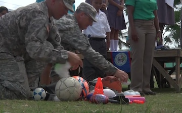 372nd Gives sports equipment to Belizean school