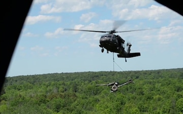 Ny Army National Guard aviators and artillerymen team up for training on Fort Drum