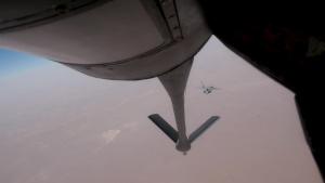 KC-135 Stratotanker Refuels F-22 Raptors and F-15 Strike Eagle