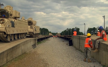 Mississippi National Guard Soldiers Unload Equipment During AT