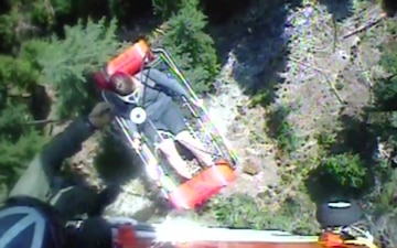Coast Guard helicopter crew hoists female hiker to safety near Agness, Oregon