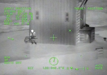 video of Coast Guard rescuing man on pier