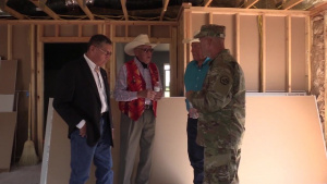 Military, Crow Leaders Tour Veteran Home Construction Site