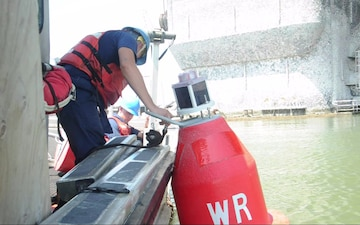 U.S. Coast Guard Fireman Seth Beach Places a Buoy in the Corpus Christi Ship Channel Following Hurricane Harvey