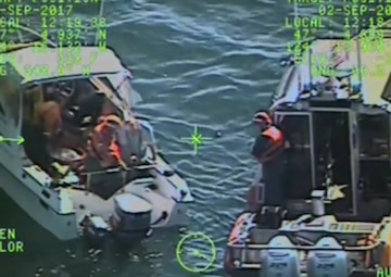 Coast Guard Station Grays Harbor boat crew members rescue two boaters from a boat taking on water off the Washington coast, Sept. 2, 2017. Two rescue crew members boarded the boat, delivered a radio and operated the dewatering pump as the Coast Guard boat crews escorted the boat back to shore. U.S. Coast Guard video by Coast Guard Sector Columbia River 6002.