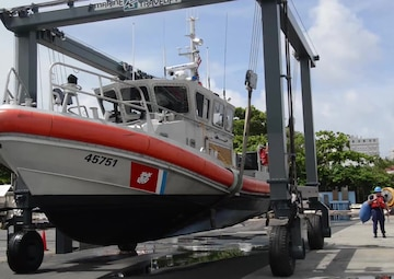 Coast Guard Station San Juan, Puerto Rico crewmembers pull the station's 45-foot Response Boat-Medium from the water in preparation of Hurricane Irma, Tuesday, Sept. 5, 2017.