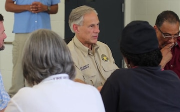 Governor Greg Abbott visits a food and water distribution point in Beaumont, Texas.