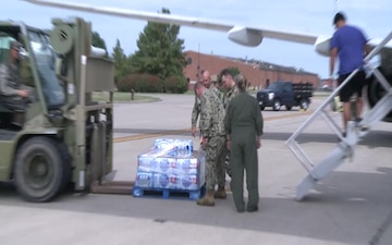 Evacuees from Naval Air Station Key West Leave Scott AFB