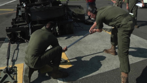 "Expeditionary Airfield Systems Technicians Install ""Bird"" Catching Gear (Package/Pkg)"