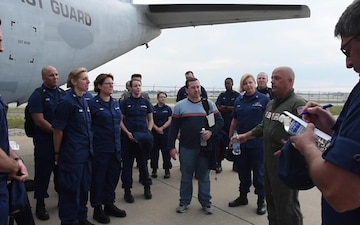 District 7 Coast Guard Personnel Boarding a C-27J Spartan