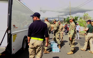 JFLCC commander and city mayor organize food, water relief in Caguas PR