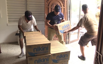 JFLCC delivers food, water relief to church in Añasco PR