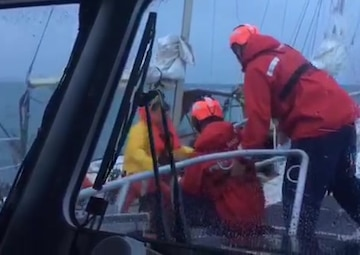 A Coast Guard Calumet Harbor Response Boat-medium crew transfers a dog aboard from a sailboat beset by heavy weather near Wilmette, Illinois, Oct. 22, 2017. The Coast Guard crew rescued three people and two dogs from the de-masted sailboat. U.S. Coast Guard video.