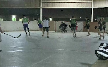 B-roll of street hockey game at the 386th AEW