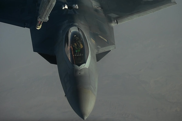 F-22 Raptors fly in formation and refuel