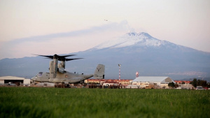 Marines fast rope from an MV-22 Osprey