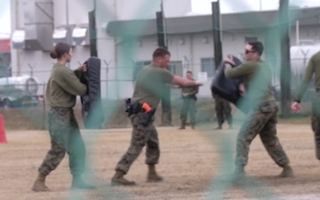 Service members on Marine Corps Air Station Iwakuni undergo challenging security augmentation force training (Package/Pkg)