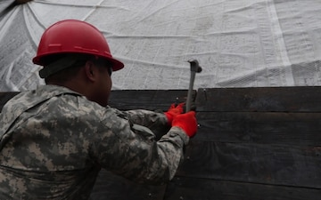 Ohio National Guard Soldiers help erect floodgates as flood waters rise in Southern Ohio