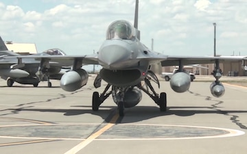 F-16s Taxi on the Flight Line
