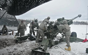 Soldiers fire a Howitzer during a live fire event