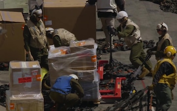 Marines and Sailors with the ARG/MEU participate in a Replenishment at sea