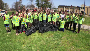 Volunteers remove trash from Shawsheen River