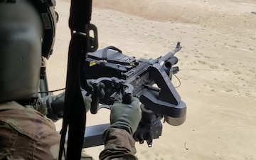 Afghan Special Mission Wing MI-17 side gunner (reload and fire)