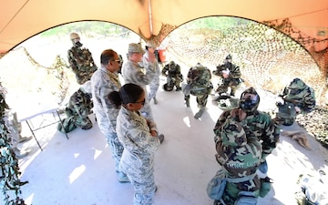 147th emergency management members train active duty counterparts in CBRNE exercises at Hickam AFB