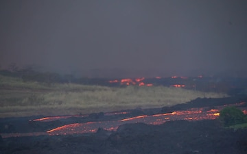 River of Lava Flows Down Valley in Hawaii