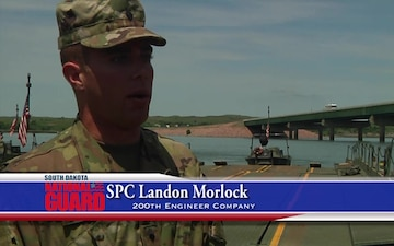 South Dakota Army National Guard 200th Engineer Company conducts a river crossing mission.