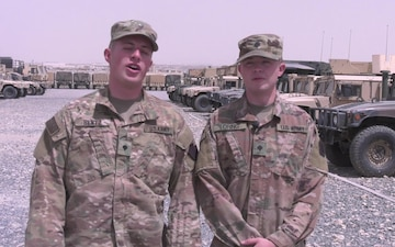 Spc. Nathan Bentz and Spc. Andrew Loring give a shout out to the Phillies