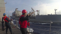 USS Lake Champlain and HMCS Vancouver conduct a replenishment-at-sea with USNS Rappahannock