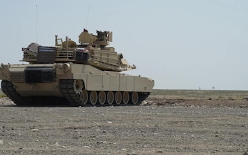Soldiers fire from M1A2 tanks at Idaho National Guard's Tank Commanders Certification Course