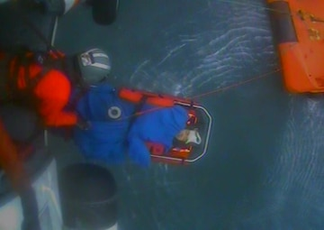 A Coast Guard Air Station Kodiak MH-60 Jayhawk aircrew medevaced a man from the fishing vessel Devotion 34 miles southwest of Cordova, Alaska, Aug. 4, 2018. To better facilitate the hoist, a 51-year-old man from the Devotion was transferred to a nearby tug. U.S. Coast Guard video by Air Station Kodiak.