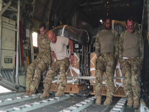 C-130 Hercules flight engineer boosts morale baking