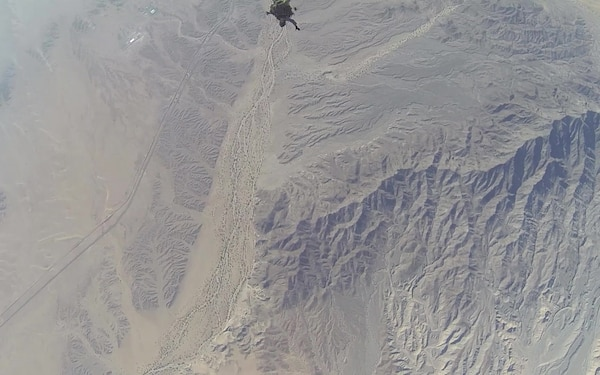 Reconnaissance Marines glide through the air during Exercise Desert Canopy