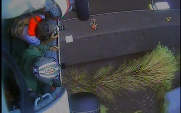 Air Station Elizabeth City saves man and his dog 'Lucky' from roof hoist camera