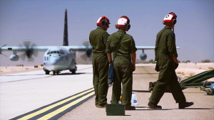 Marines simultainiously refuel and load ordnance