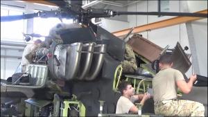Company D, 1st Battalion, 3rd Aviation Regiment (Attack Reconnaissance) conduct 500 hours phase maintenance on a AH-64 Apache